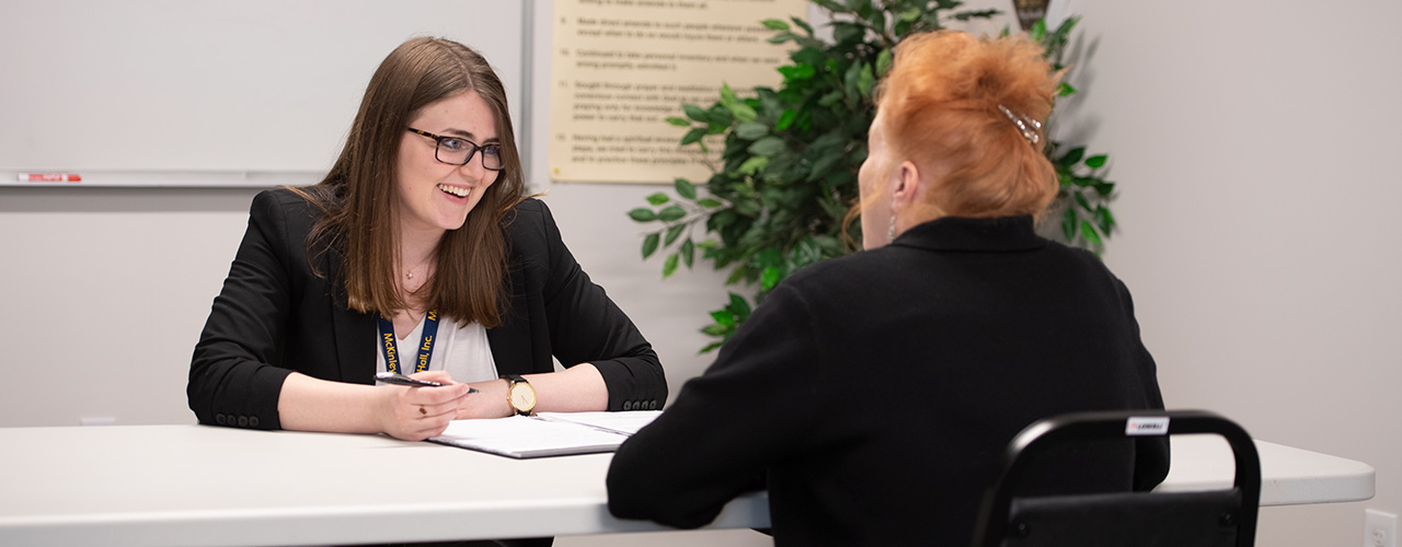 Social work student talking with a client.