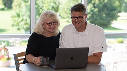 Cedarville parents looking a laptop computer