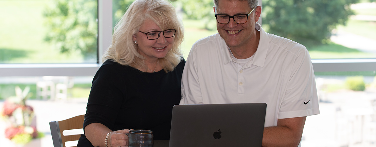 Cedarville parents viewing a laptop