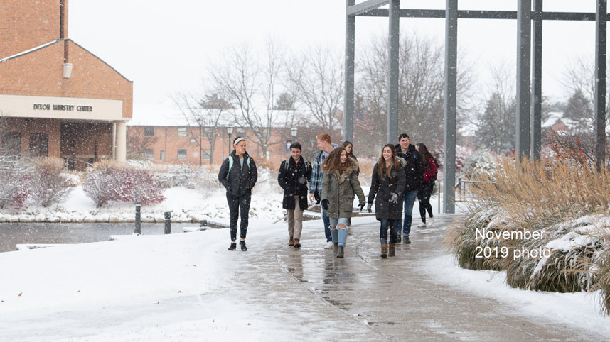 Students walking past the BTS with snow on the ground