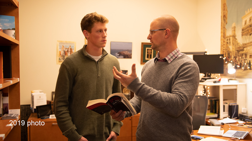 Caleb Pene talking with Dr. Matt Bennett