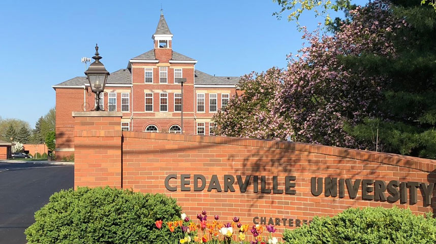 Founders Hall with Cedarville University sign in foreground