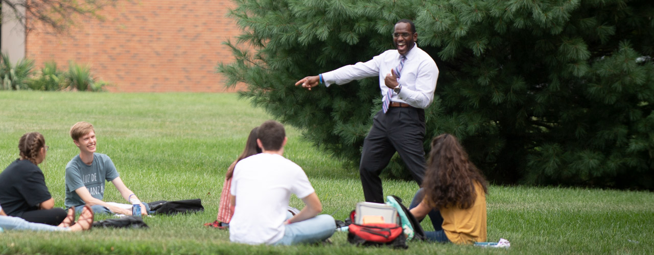 Dr. Kevin Jones standing with a class outside