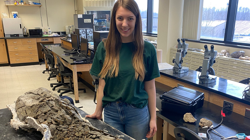 Sara Mitchell with the Diplodocus femur