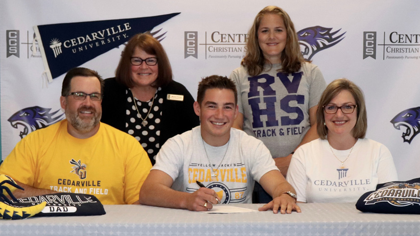 Shaun, Luke, and Diane Hannay (front row) at Luke's signing for Cedarville