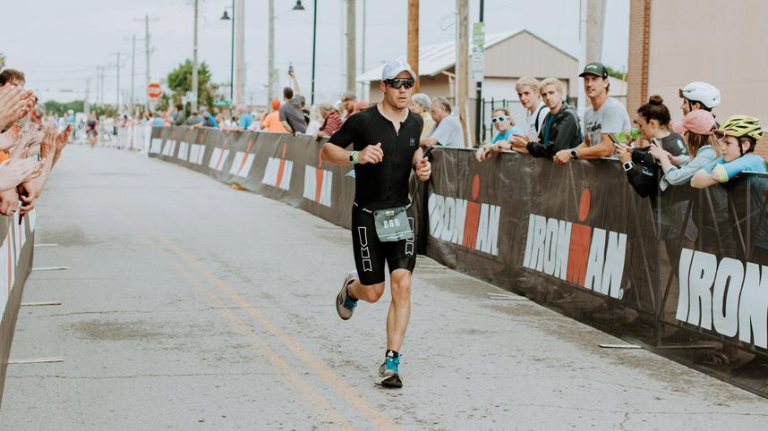 Cedarville men's soccer head coach Brett Faro heading for the finish line of the Ironman Tulsa triathlon on May 23, 2021