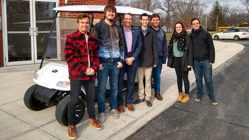 Left to right: Jake Lysack, Daniel Parker, Dr. White, Anson Allard, Joel Beckmeyer, Emma Burgess, Daniel Garcia pose in front of the new golf cart that Dr. White purchased for the autonomous vehicle project.