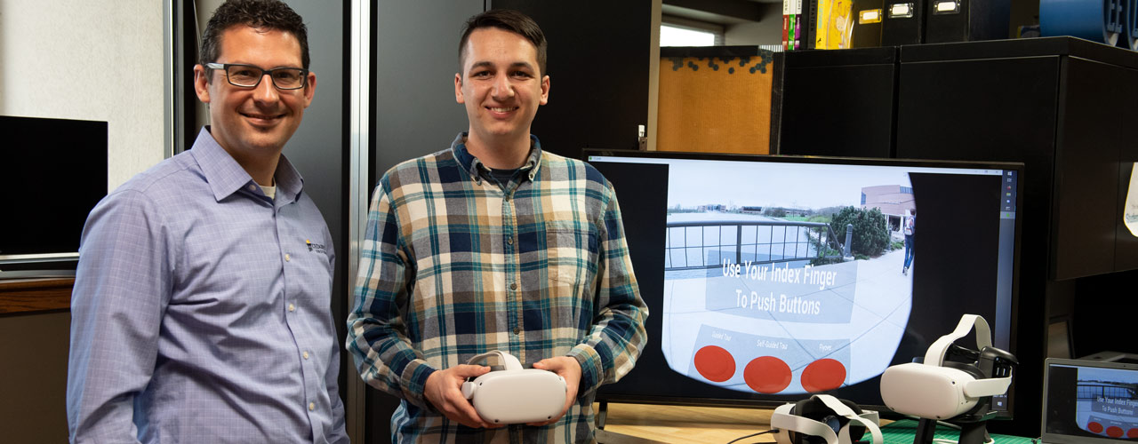 Chad Jackson, Cedarville creative director, and Jackson Bishop, 2021 computer science graduate and VR app creator