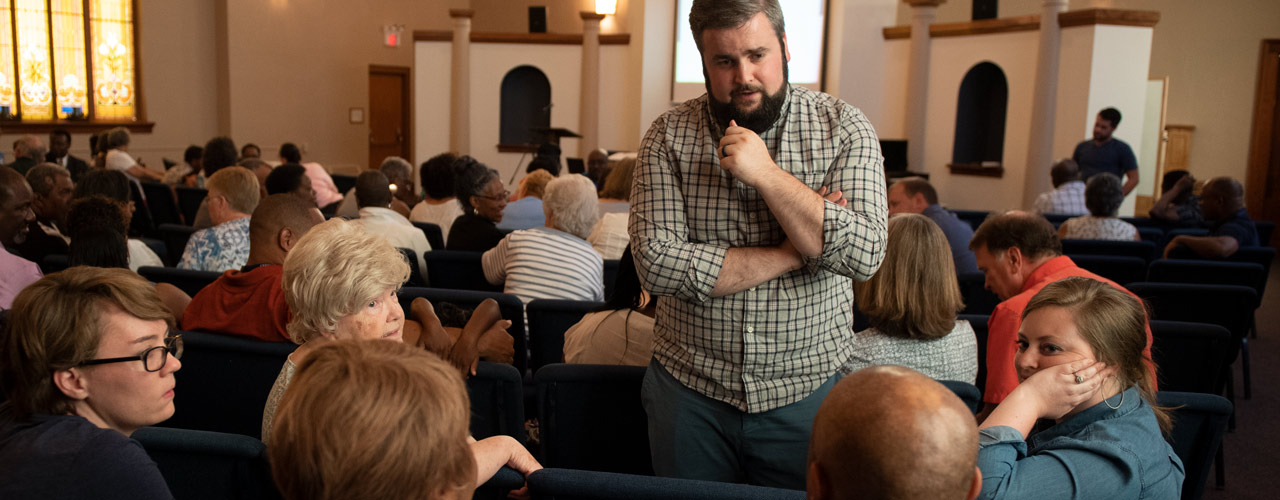 People talking in a church building
