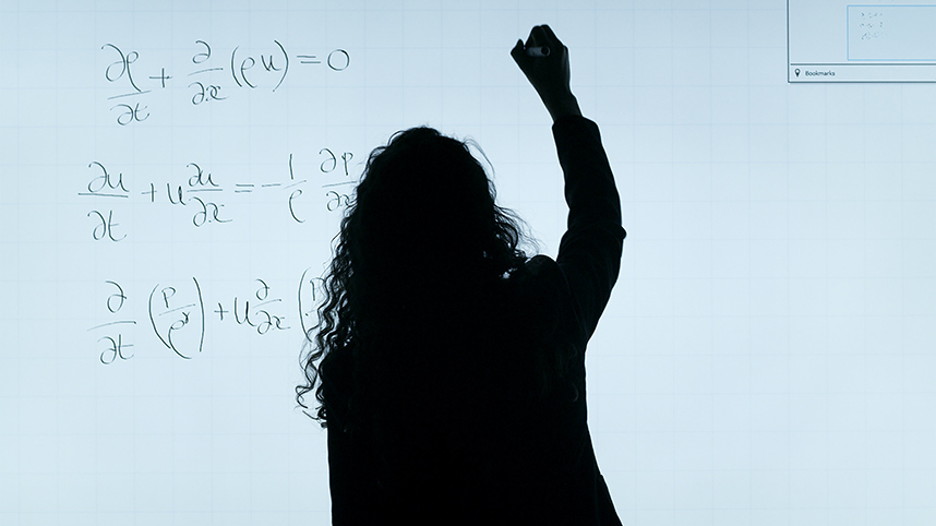 Female engineer doing math problem