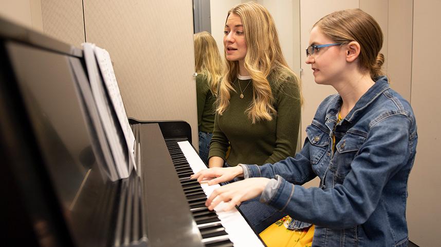Female pianist accompanying a female soloist