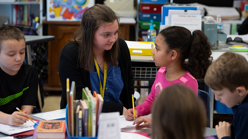 Female student teacher talking with a student