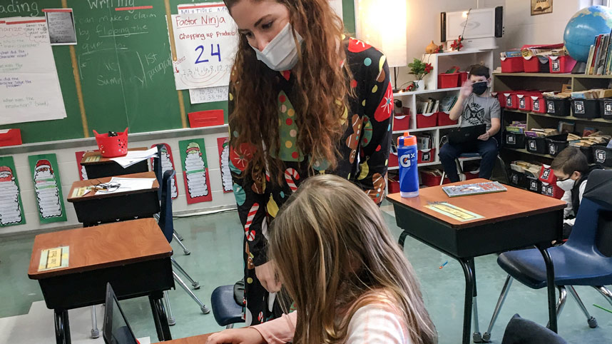 Kylie Beste with student