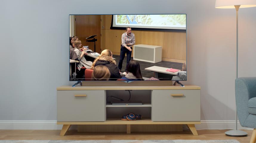 Dr. Chris Miller teaching OT Literature on a TV screen