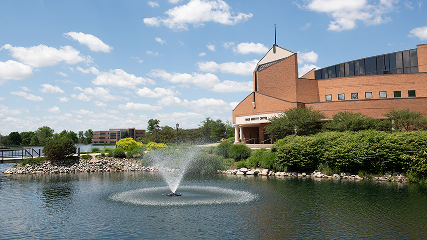 Dixon Ministry Center with fountain spraying water in foreground