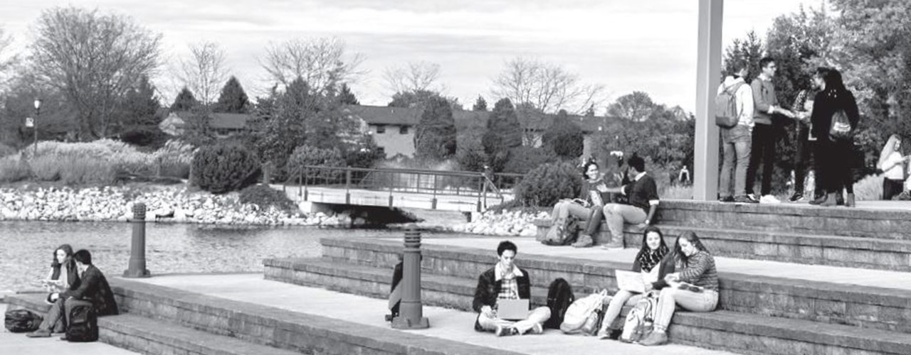 Students sitting on the steps outside the School of Biblical and Theological Studies