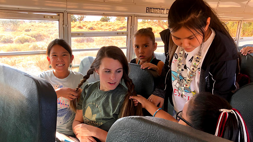 A Discipleship Council member traveling on a school bus with Immanuel Mission kids