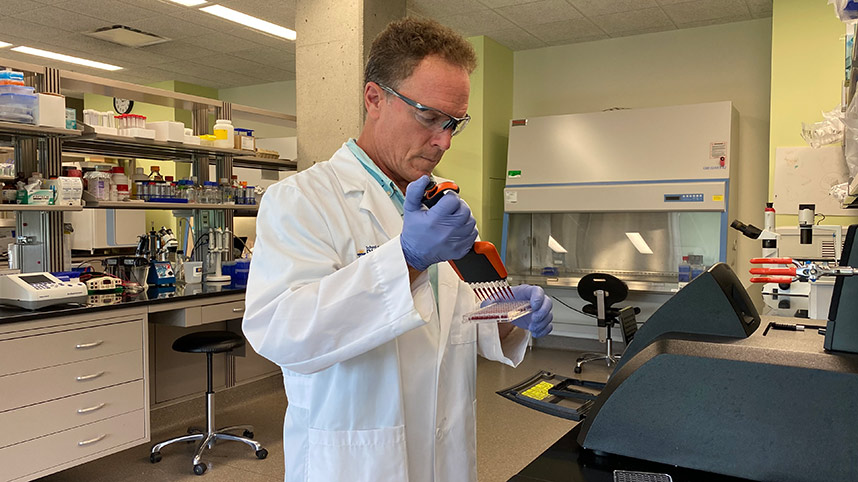 Dr. Rocco Rotello working in the pharmacy lab
