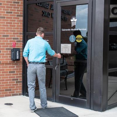 Man opening door to UMS