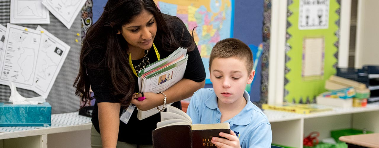 Student teacher helps middle school boy read the Bible