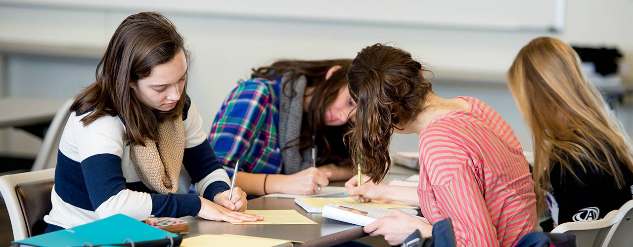 Four female students work on a group project