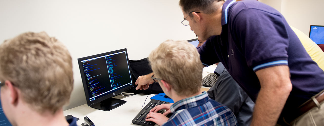 Professor assists students in the cyber-security lab
