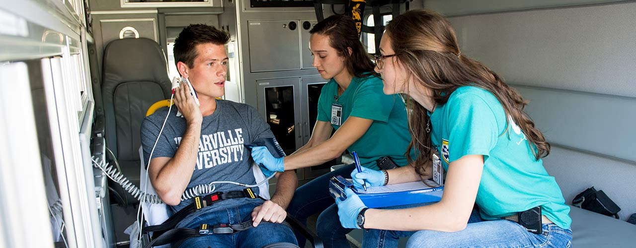 Students assist a patient in Cedarville's own EMS unit
