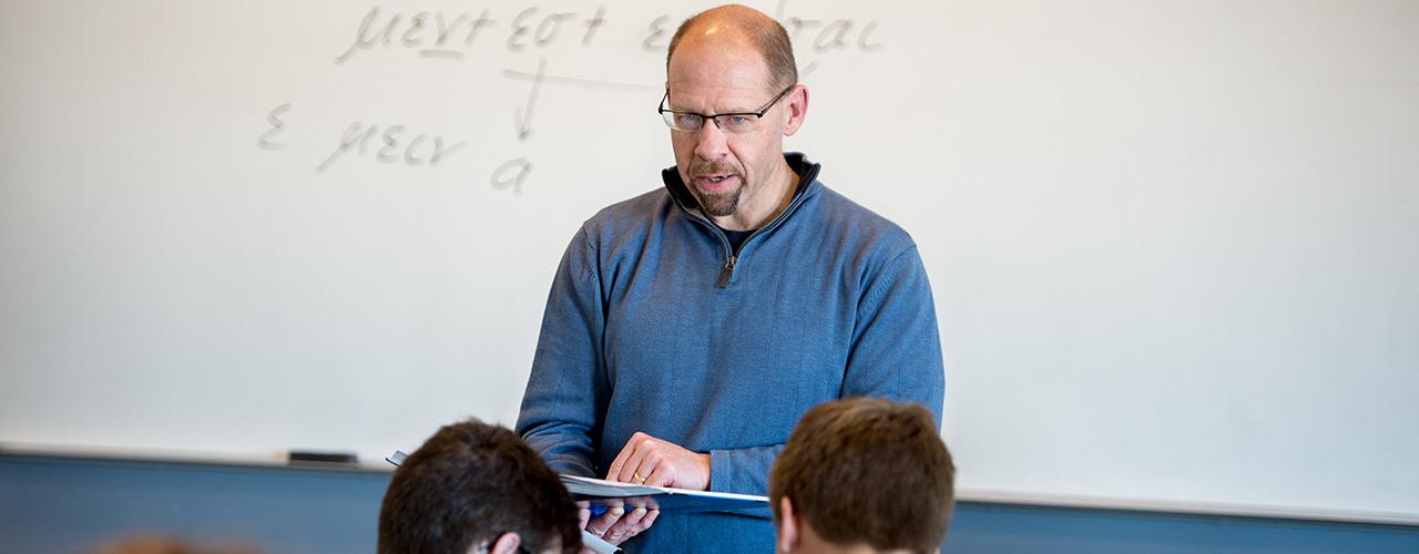 Professor lectures about Greek grammar
