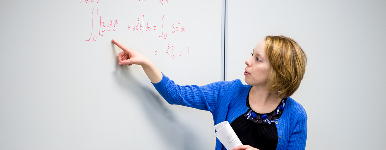 Professor points out an integral on a white board