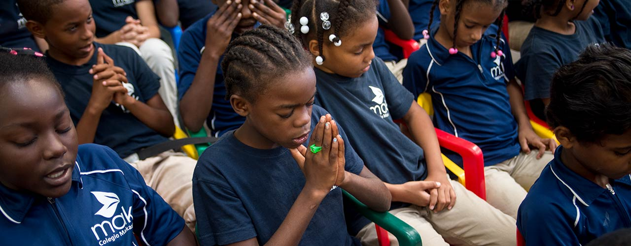 African children kneeling and praying