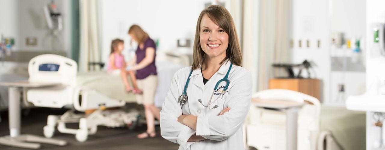 Female Nurse Practitioner stands in hospital