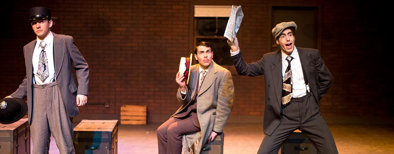 Three male theatre majors act out a scene