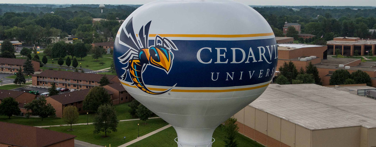 Cedarville's water tower painted with the yellow jacket mascot