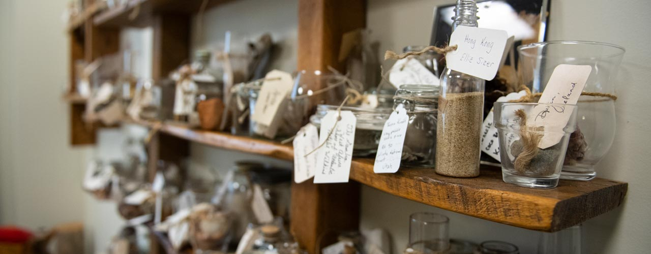 picture of glass objects with tags on a shelf in the Cove