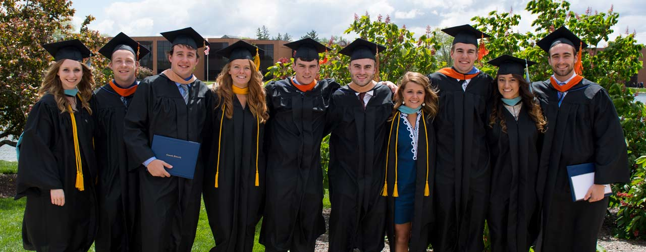 Group of Cedarville graduates smile by the lake