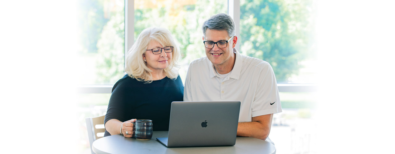 Couple looking over computer