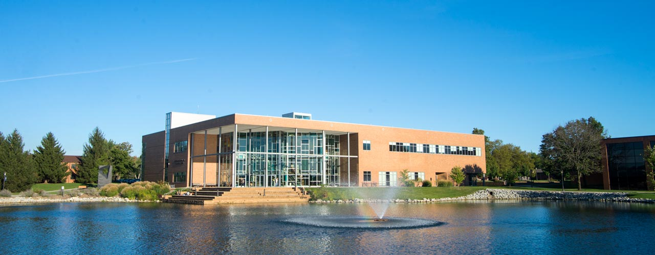 The Biblical and Theological Studies building sits by Cedar Lake