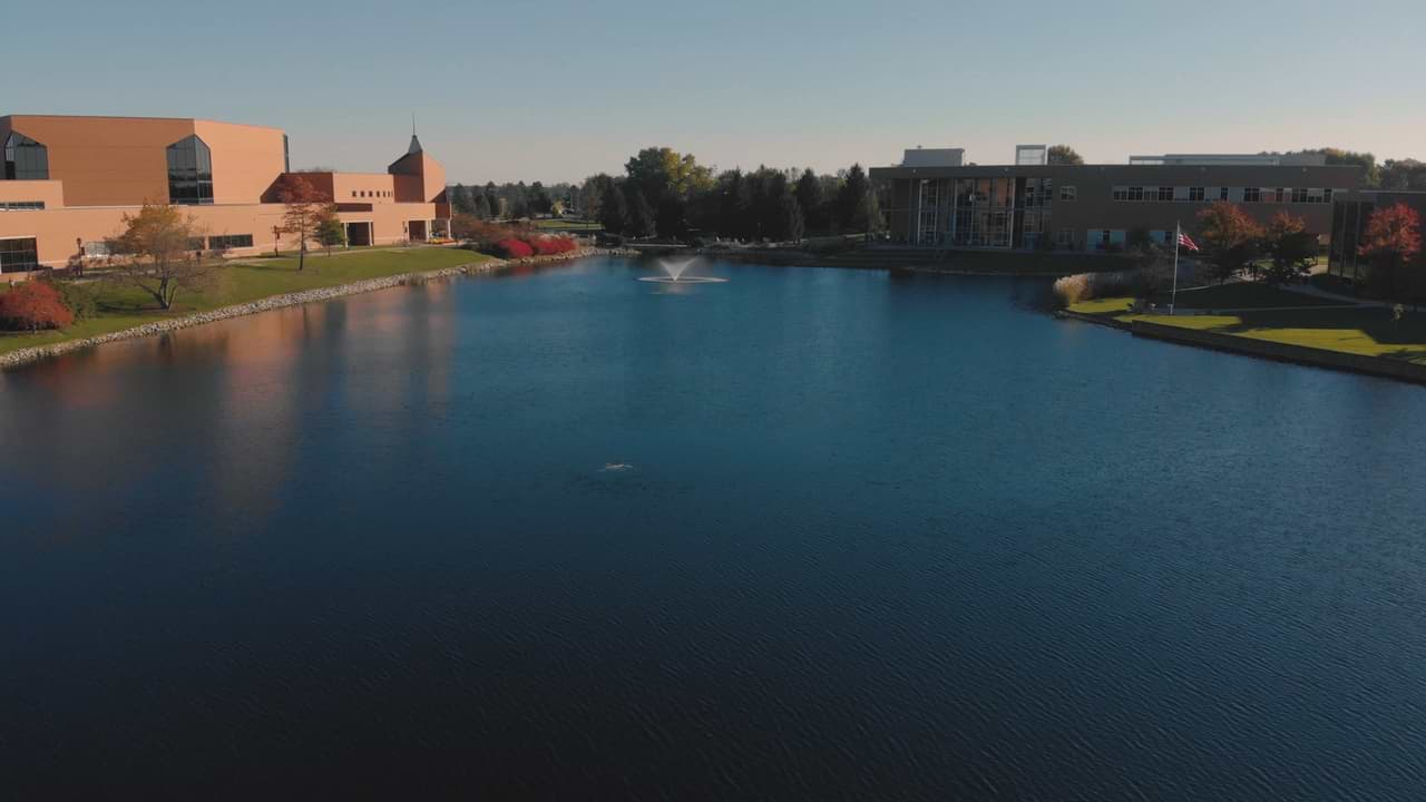 Arial view of campus overlooking the lake with the DMC on the left and the BTS on the right