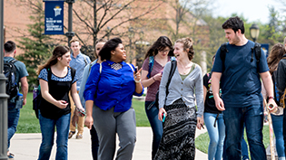 Students laugh and discuss walking from chapel