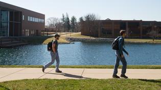 Students walking down the sidewalk outside of chapel