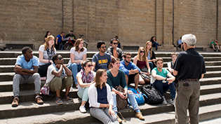 Professor lectures students studying abroad