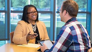 Student discusses MBA program with professor