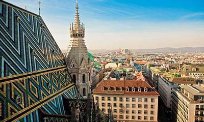 Aerial photograph of St. Stephen's Cathedral in the foreground and the city of Vienna, Austria in the background.