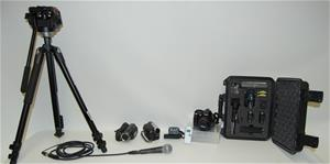 Camera on tripod and a case with various lenses
