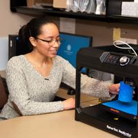student at 3D printer