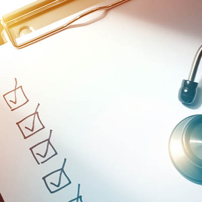 A checklist with a stethoscope on top