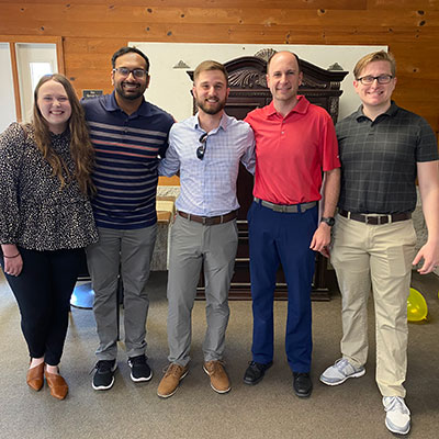 Female Alumni panel sitting behind table and smiling