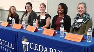 Five female alumni seated at a table.