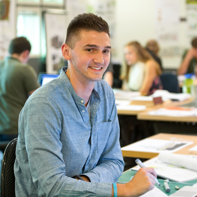 Male student smiles at camera