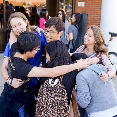 Group of international students hugging